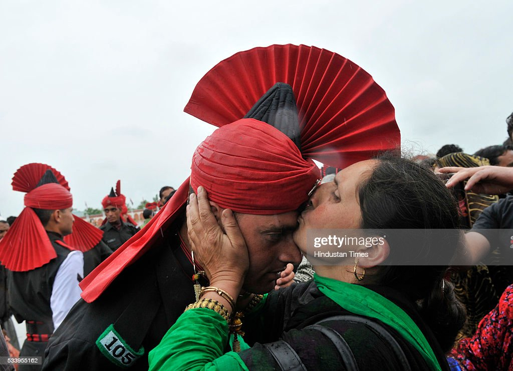 A mother kisses the forehead of her son after he graduated as an soldier during a passing out parade at an army base on May 24, 2016 near Srinagar, India.249 young men from Jammu & Kashmir were formally inducted into the Army Jammu and Kashmiri Light Infantry Regiment (JKLIR) after nine months of rigorous training.