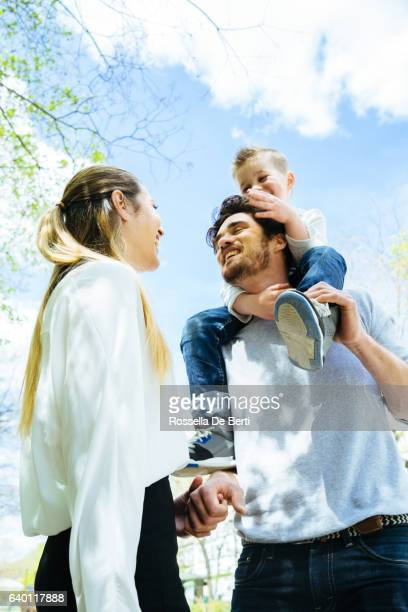 Mother Kissing Goodbye Husband And Son Before Going To Work