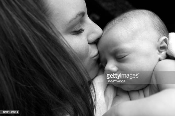 Mother Kissing Newborn Son