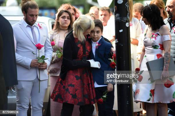 Mother Lisa brother Alexander and family members look on prior to the funeral service of Manchester Arena bomb victim SaffieRose Roussos at...