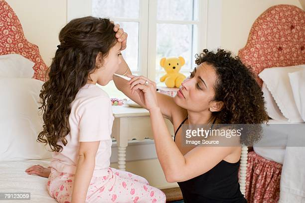 Mother looking after daughter