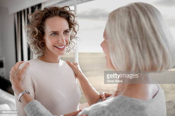 Mother looking at adult daughter