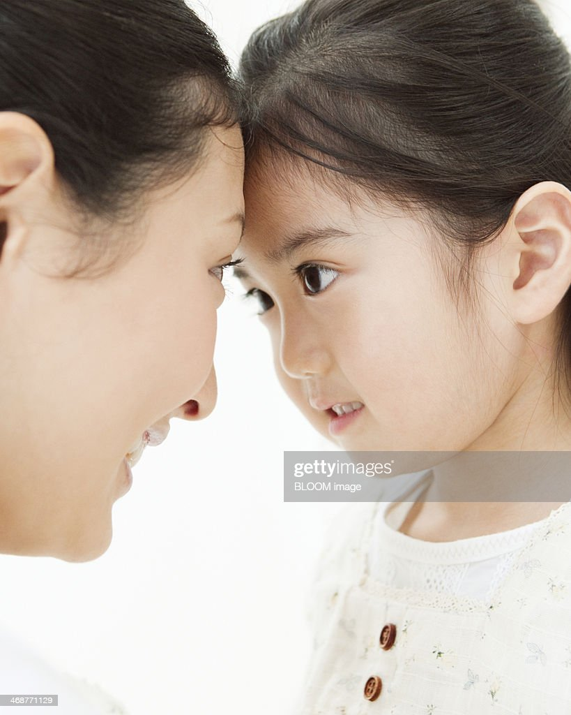 Mother Looking At Daughter : Stock Photo
