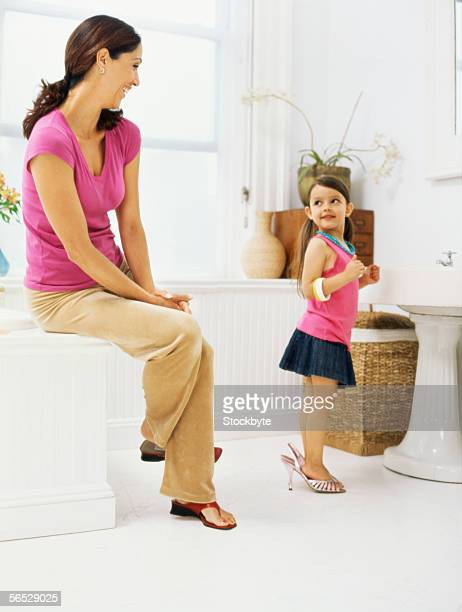 mother looking at her daughter