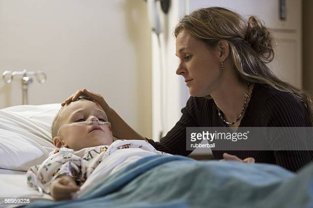 Mother looking at her son in the hospital