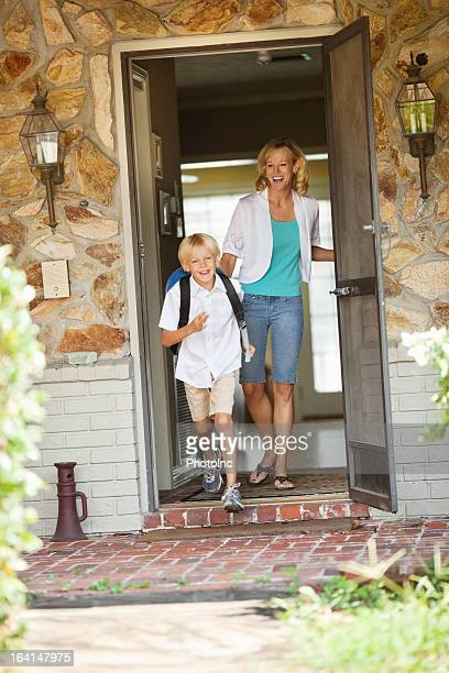 Mother Looking At Son Leaving For School