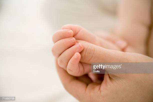 Mother massaging baby?s hand