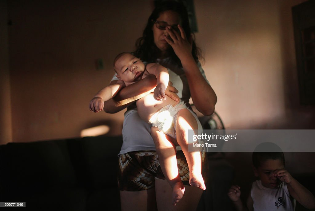 Mother Mylene Helena Ferreira holds her son David Henrique, 5 months, who has microcephaly, on January 25, 2016 in Recife, Brazil. In the last four months, authorities have recorded close to 4,000 cases in Brazil in which the mosquito-borne Zika virus may have led to microcephaly in infants. Microcephaly results in newborns with abnormally small heads and is associated with various disorders including decreased brain development. According to the World Health Organization (WHO), the Zika virus outbreak is likely to further spread in South, Central and North America. At least twelve cases of Zika in the United States have now been confirmed by the CDC.