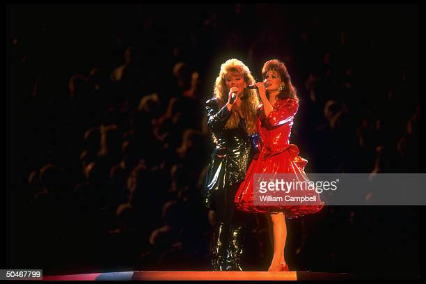 Mother Naomi daughter Wynonna of eponymous c/w group The Judds giving farewell performance as duo due to Naomi's chronic hepatitis