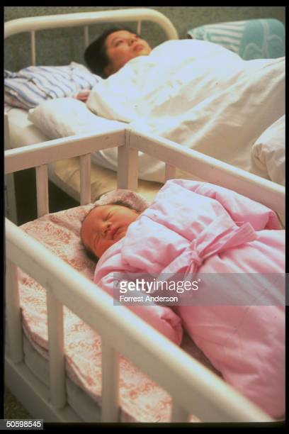 Mother newborn baby boy at Beijing Maternity Hospital re proposed eugenics law aimed at diseased retarded to improve quality of population