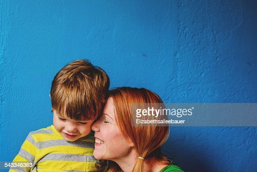 Mother nuzzling sons (2-3) face