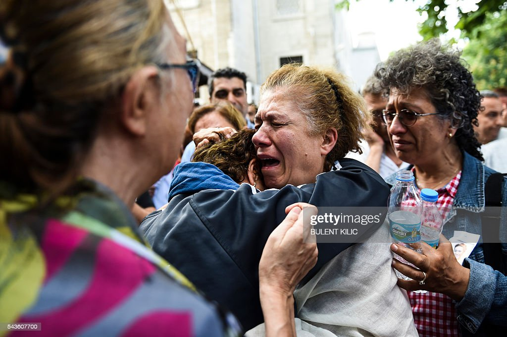 Mother (C) of an air hostess Gulsen Bahadir killed during last night attacks cries during the funeral in Istanbul, on June 29, 2016, a day after a suicide bombing and gun attack targeted Istanbul's airport, killing at least 36 people. A triple suicide bombing and gun attack that occurred on June 28, 2016 at Istanbul's Ataturk airport has killed at least 36 people, including foreigners, with Turkey's prime minister saying early signs pointed to an assault by the Islamic State group. / AFP / BULENT