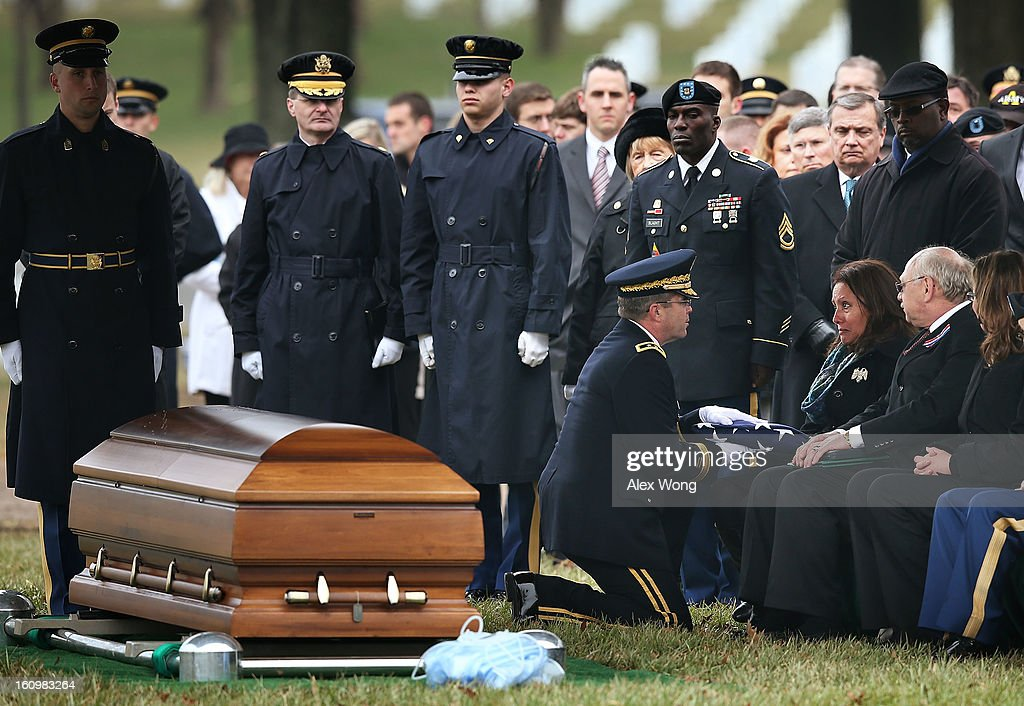 Mother of Army Sergeant Aaron X. Wittman, Bertha Wittman (3rd R) is presented with a flag by U.S. Army Military Personal Management Director Major General Thomas Seamands (4th R) as father Duane Wittman (2nd R) looks on during his funeral February 8, 2013 at Arlington National Cemetery in Arlington, Virginia. Sergeant Wittman, 28, of Chester, Virginia, was assigned to 3rd Battalion, 69th Armor Regiment, 1st Brigade Combat Team, 3rd Infantry Division in Fort Stewart, Georgia. He died on January 10, 2013 in Khogyani District of Nangarhar Province in Afghanistan, from injuries sustained after his unit was hit by a small arms fire.