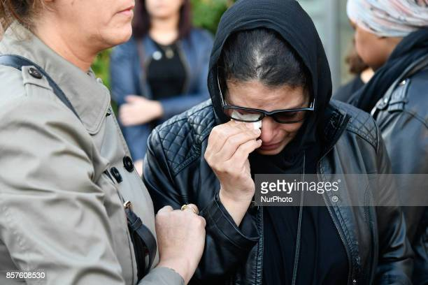 Mother of Bilel and Yacine ben kahlal cry over her beloved dead son in front of the Bobigny's court in Paris France on October 4 2017
