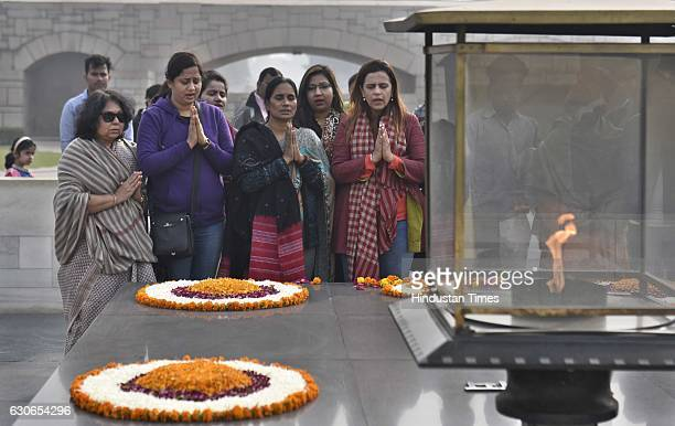 Mother of Delhi gangrape victim Jyoti Singh who is also known as Nirbhaya paying tribute to Nirbhaya with relatives and supporters at Rajghat on her...