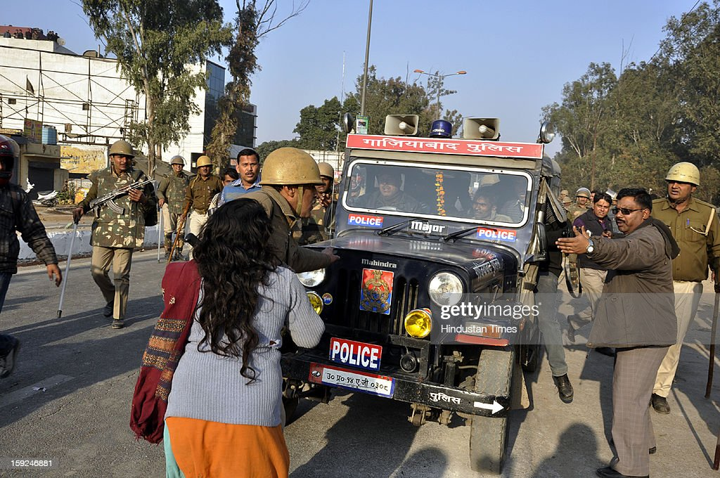 Mother of five year old girl who was found dead at a vacant plot of land in Subhash Nagar locality trying to stop police from taking dead body of girl for post mortem on January 10, 2013 in Ghaziabad, India. The incident triggered large scale riots in which many vehicles were damaged.