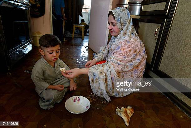 Mother of Leith Fuad Mosa age 3 feeds him before he is circumcised on June 29 2007 in Baghdad Iraq Circumcision the procedure that removes part or...