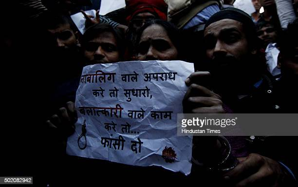 Mother of Nirbhaya holds a slogan demanding the death penalty for the man convicted over the fatal December 16 gangrape during a protest against his...