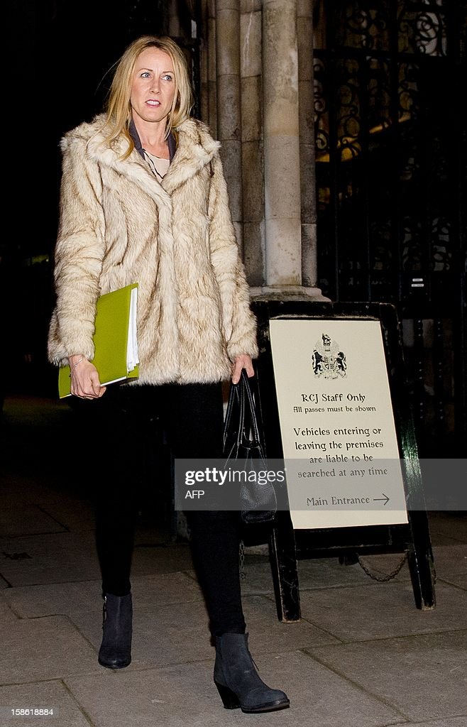 Mother of seven year old cancer sufferer Neon Roberts, Sally Roberts leaves the High Court in central London on December 21, 2012. A British judge ruled that a seven-year-old boy with cancer can have radiotherapy treatment despite his mother's opposition. New Zealander Sally Roberts, 37, had refused to give consent for her son Neon to receive radiotherapy to treat a brain tumour, fearing that it would cause him long-term harm and arguing that 'credible' alternative treatment was available. AFP PHOTO/Leon Neal