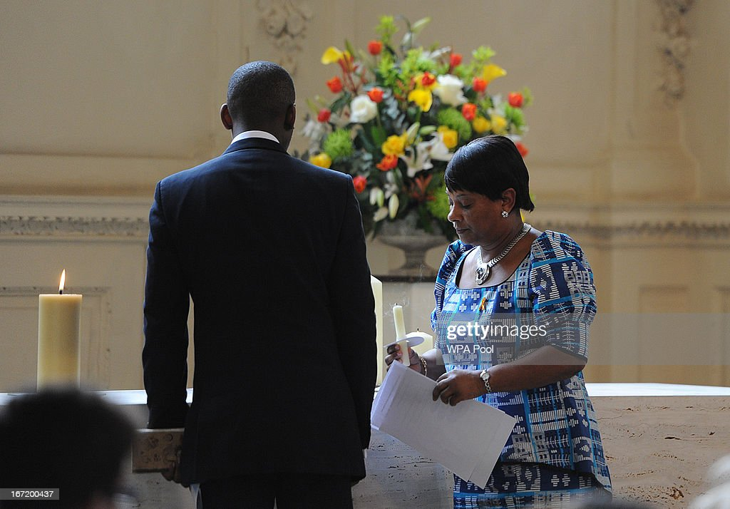 Mother of Stephen Lawrence, Doreen Lawrence, and her son Stuart Lawrence (R) light candles during a memorial service for Stephen Lawrence at St Martin-in-the-Fields Church on April 22, 2013 in London, England. Stephen Lawrence, a black A-level student was stabbed to death at a bus stop twenty years ago by a gang of white youths in a racially motivated attack in Eltham, south-east London, on April 22, 1993. Two men, Gary Dobson and David Norris were found guilty of his murder in January 2012.