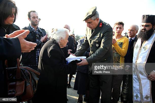 Mother of the dead soldier receives the Flag of Cyprus and the Flag of Greece as an indication for her hero son Funeral of Gianni Loukas who was...