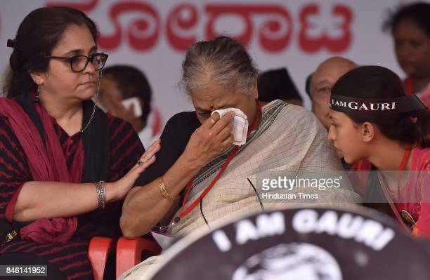 Mother of the slain journalist Gauri Lankesh gets emotional as Indian Civil Rights activist Teesta Setalvad looks on during a public rally by the...