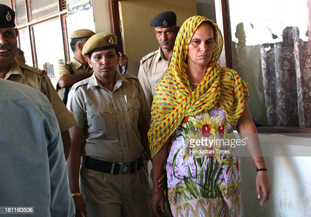 Mother of the victim girl and main accused Rita Barak is being taken to court in case of honor killing on September 19 2013 in Rohtak India The...