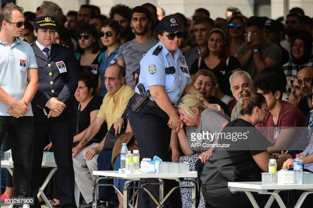 Mother of Turkish police officer Sinan Acar killed last night mourns during his funeral ceremony at Istanbul's police department headquarters in...