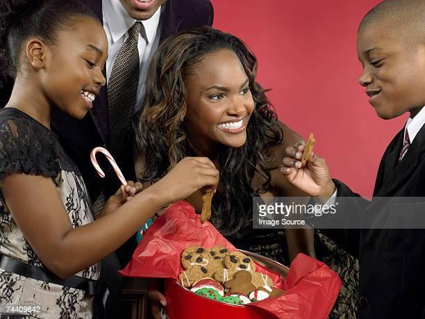 Mother offering children gingerbread men