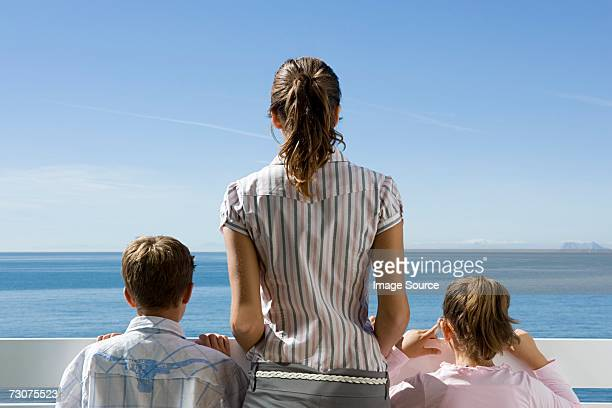 Mother on balcony with children