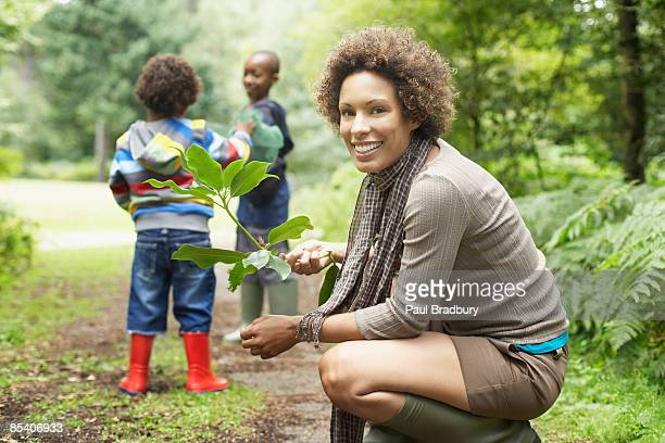 Mother outdoors with children