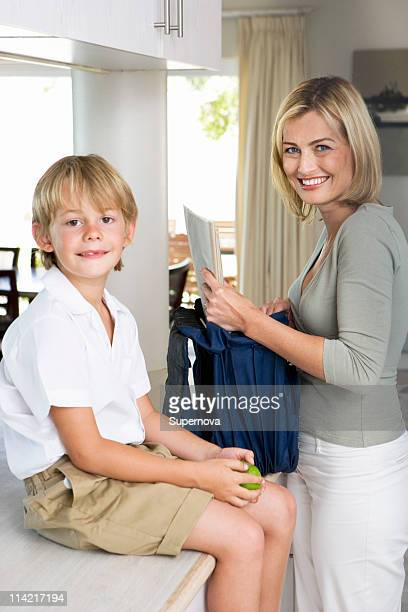 Mother packing son's school bag, Cape Town, Western Cape Province, South Africa