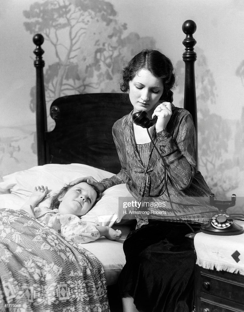 Mother Phone Calling Doctor Child Daughter Girl Sick Bed With Fever Medical Medicine House Call Health Sickness Ill Ailing Retro. : Stock Photo