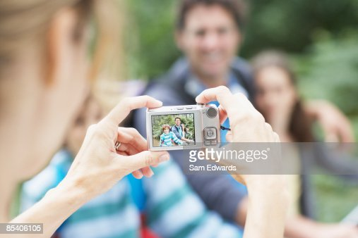 Mother photographing family : Stock Photo