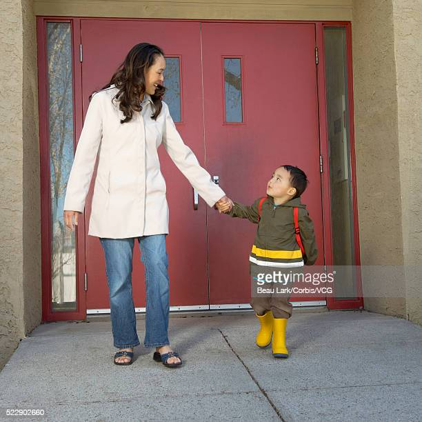 Mother picking her son up from preschool