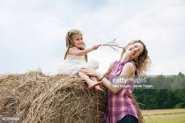 Mother playing outdoors with her daughter.