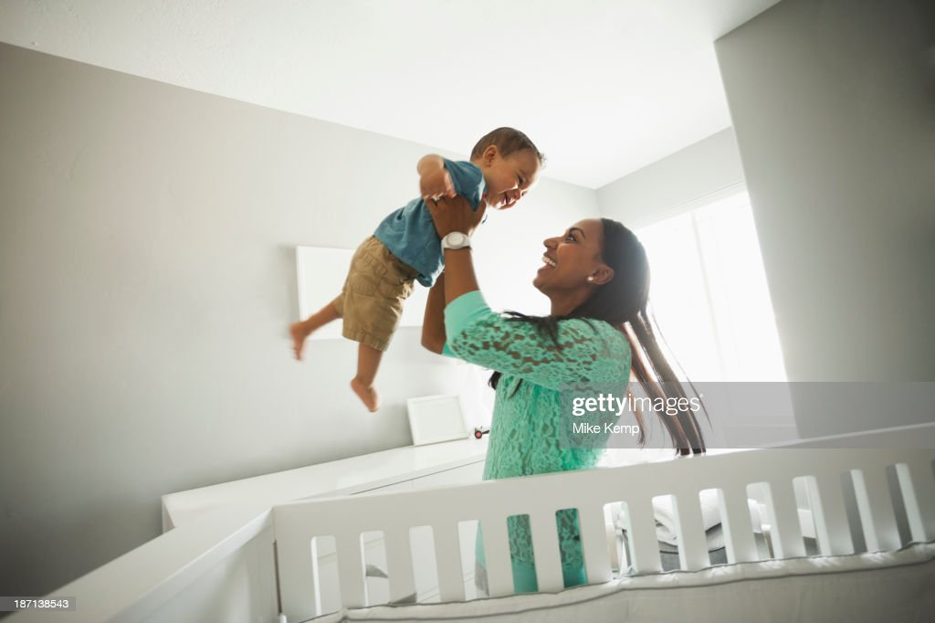 Mother playing with baby boy : Stock Photo