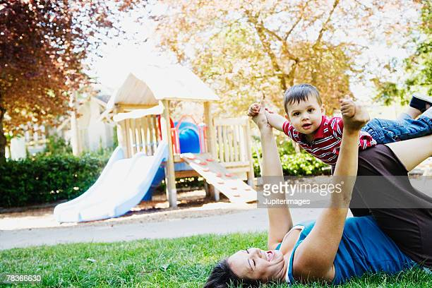 Mother playing with son at playground
