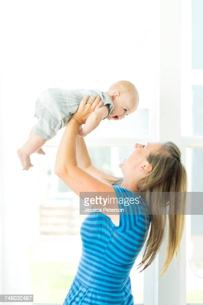Mother playing with son (6-11 months)