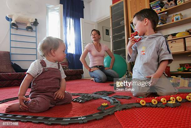 Annette Wassermann plays with her sons Damian and Leander 16 months at home after work May 9 2006 in Berlin Germany Wassermann and her husband Kostas...