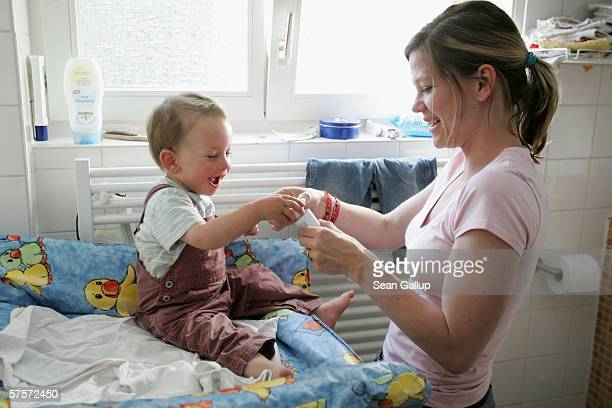 Annette Wassermann plays with her son Leander 16 months at home after work May 9 2006 in Berlin Germany Wassermann and her husband Kostas Kosmas who...