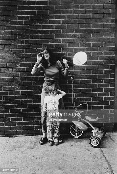 A mother poses with her son New York City 1974