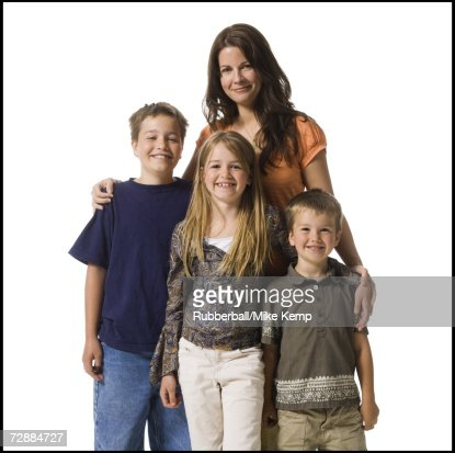 Mother posing with sons and daughter