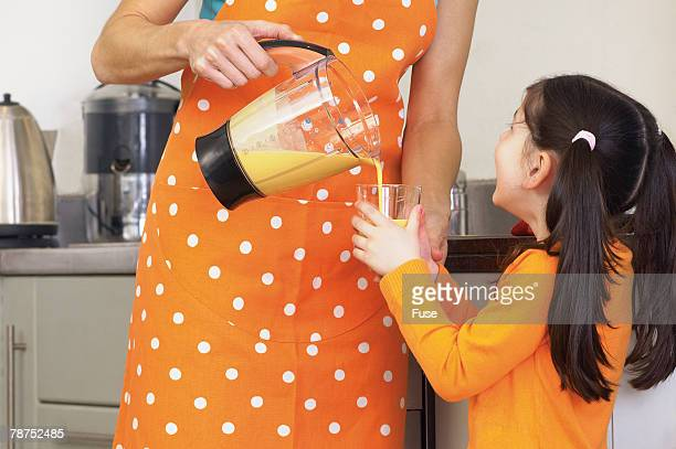 Mother Pouring Daughter Smoothie