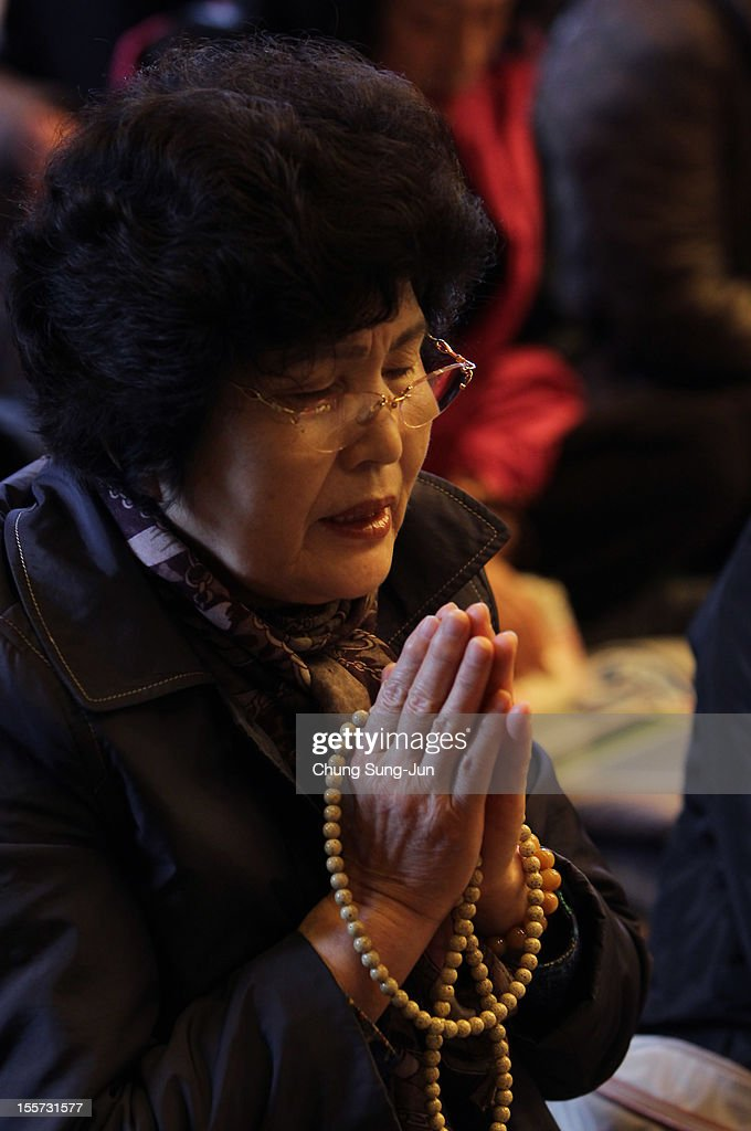A mother pray for her children taking the College Scholastic Ability Test at Chogey temple on November 8, 2012 in Seoul, South Korea. More than 660,000 high school seniors and graduates sit for the examinations at 1,100 test centers across the country, where academic records are all important. Success in the exam, one of the most rigourous standardized tests in the world, enables students to study at Korea's top universities.