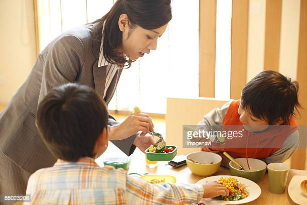 Mother preparing a lunchbox