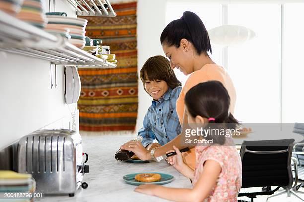 Mother preparing breakfast for children (6-10)