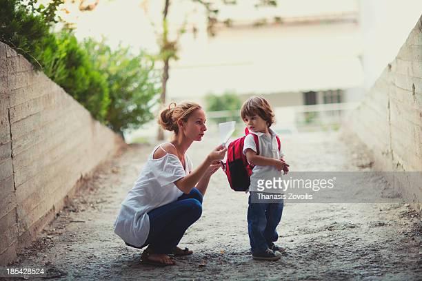 Mother preparing her kid for school