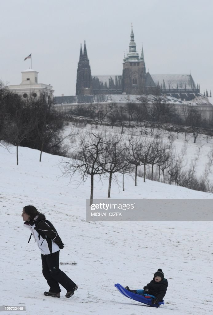 A mother pulls her son at the snow covered Petrin hill on January 19, 2013 in Prague.