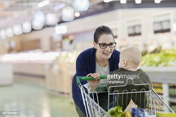 Mother pushing baby in grocery store